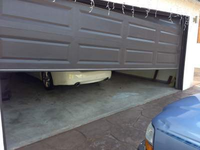 Exceptional An Off Track Garage Door Can Cause Accidents And Also Loss Of Money Besides  Looking Awful. It Is Not Advisable To Handle This Kind Of Door With Novice  Hands ...