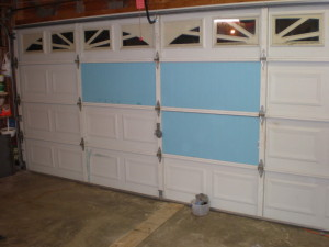 garage door insulation being installed in a new garage door in seattle wa & Guide to Garage Door Insulation - Garage Door Seattle WA